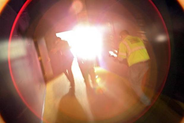 Followed by news photographers, Oklahoma City Police Officers search through rooms at the old post office building during a training exercise at the building near SW 5th and Hudson in Oklahoma City on Wednesday, July 22, 2009. By John Clanton, The Oklahoman