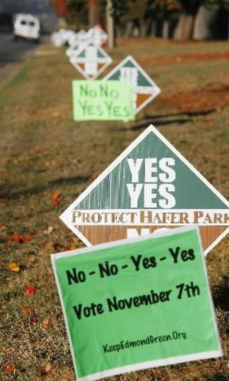No-No-Yes-Yes and Yes-Yes-No-No signs across from Holy Trinity Lutheran Church where voters from precinct 353 and 354 vote in Edmond, Tuesday, November 7, 2006. Photo by David McDaniel, The Oklahoman