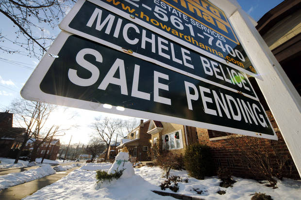 In this Saturday, Jan. 5, 2013, photo, a sale pending sign is outside of a house in Mount Lebanon, Pa. A measure of the number of Americans who signed contracts to buy homes rose in January from December to the highest level in more than 2 ½ years. The increase suggests sales of previously occupied homes will continue rising in the coming months. (AP Photo/Gene J. Puskar)