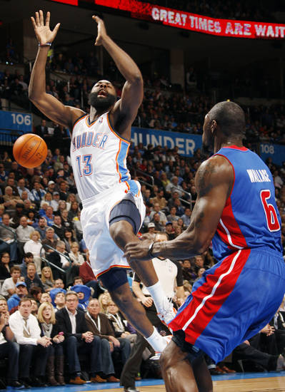 Oklahoma City's James Harden (13) loses the ball after being fouled near Ben Wallace (6) of Detroit during the NBA basketball game between the Detroit Pistons and Oklahoma City Thunder at the Chesapeake Energy Arena in Oklahoma City, Monday, Jan. 23, 2012. Photo by Nate Billings, The Oklahoman