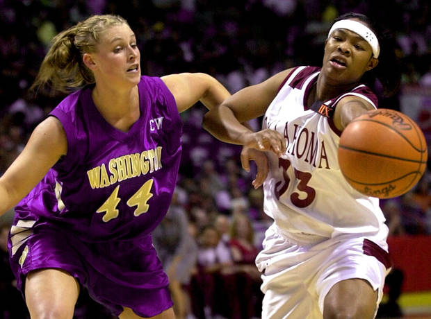NCAA WOMEN&#039;S BASKETBALL TOURNAMENT: OU&#039;s Rosalind Ross tries to pass the ball around Cheryl Sorenson of Washington during OU&#039;s loss in the sweet sixteen in Spokane.  Staff photo by Bryan Terry