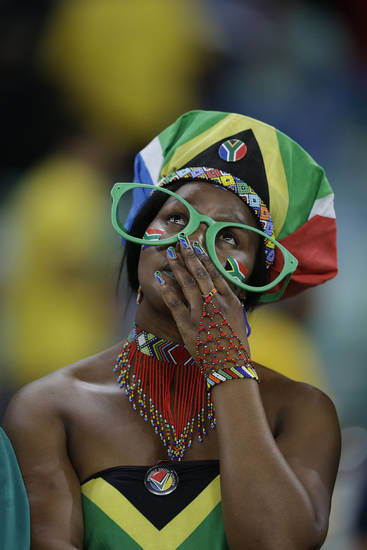 A South Africa fan reacts as her team is knocked out of the African Cup of Nations after losing to Mali on penalties in their quarterfinal soccer match, at Moses Mabhida Stadium in Durban, South Africa, Saturday, Feb. 2, 2013. (AP Photo/Rebecca Blackwell)