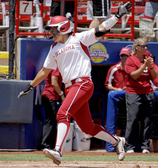 Oklahoma's Lauren Chamberlain celebrates as she heads towards home after hitting a home run against South Florida in the fourth inning of a Women's College World Series game at ASA Hall of Fame Stadium in Oklahoma City, Thursday, May 31, 2012.  Photo by Bryan Terry, The Oklahoman