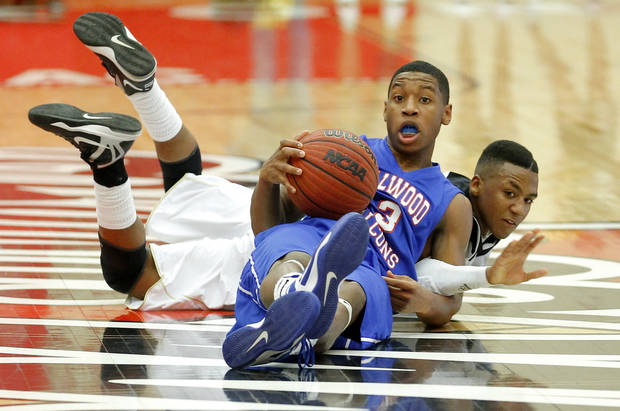 Milloowd's Cameron Batson and Hugo's Nick Brown fight for the ball during a Class 3A boys state basketball tournament game between Hugo and Millwood at Yukon High School in Yukon, Okla., Thursday, March 7, 2013. Photo by Bryan Terry, The Oklahoman
