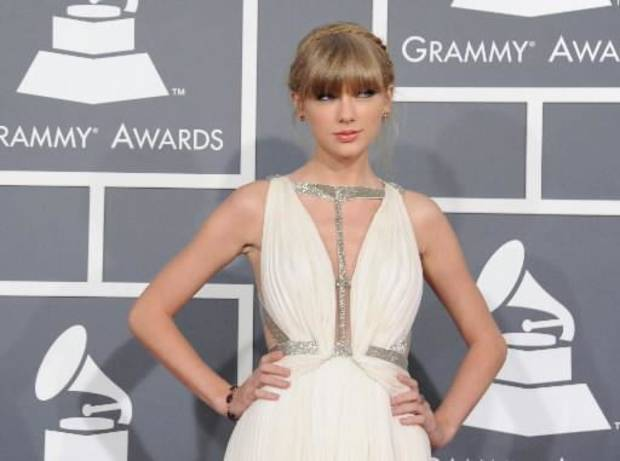 aylor Swift arrives at the 55th annual Grammy Awards on Sunday, Feb. 10, 2013, in Los Angeles. (AP)