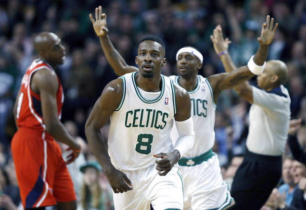 Boston Celtics' Jeff Green (8) comes up court followed by teammate Jason Terry, behind right, after hitting a 3-pointer during the fourth quarter of NBA basketball game in against the Atlanta Hawks Boston, Friday, March 8, 2013. The Celtics won 107-102 in overtime. (AP Photo/Michael Dwyer) ORG XMIT: MAMD111