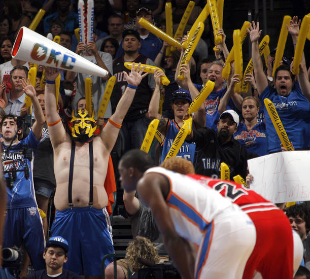 Fans try to distract the Bulls' during the NBA basketball game between the Chicago Bulls and the Oklahoma City Thunder at Chesapeake Energy Arena in Oklahoma City, Sunday, April 1, 2012. Photo by Sarah Phipps, The Oklahoman