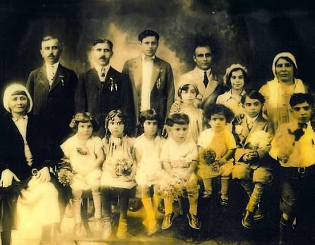 This 1928 photo shows Hussien Karoub, back row second from left, with his family. Wanting to fill some ancestral gaps, Detroit Associated Press reporter Jeff Karoub is piecing together the story of his grandfather, Hussien Karoub, who immigrated to America in 1912. (AP Photo/Karoub Family)