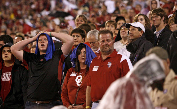 Fans look toward the sky during a weather delay before the college football game between the University of Oklahoma Sooners (OU) and Texas Tech at Gaylord Family-Oklahoma Memorial Stadium in Norman, Kansas, Saturday, Oct. 22, 2011. Photo by Bryan Terry, The Oklahoman