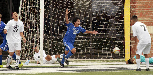 Santa Fe South's  Santiago Montalvo (23), Jesus Andrade (in net) and Christian Morales (7) react as Mount Saint Mary's Connor Hartzell (26) heads the ball in for an overtime win at the Oklahoma State 4A Boys Championship soccer game in which Mount Saint Mary won 2-1 on Saturday, May 12, 2012, in Newcastle, Okla. Photo The Oklahoman, Steve Sisney