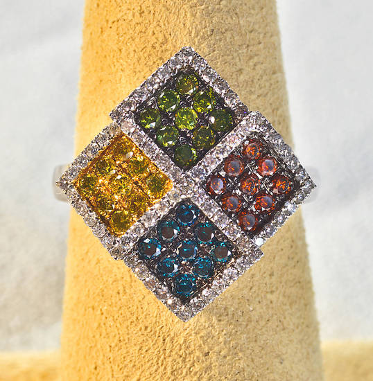 Multicolor diamond ring features pink, blue, green, yellow and white diamonds. Sold at Samuel Gordon Jewelers. Photo by Chris Landsberger, The Oklahoman. <strong>CHRIS LANDSBERGER</strong>