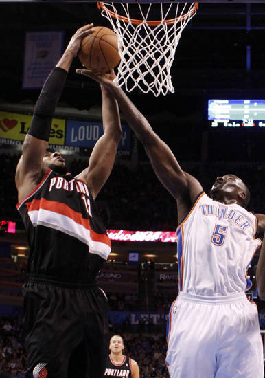 Oklahoma City's Kendrick Perkins (5) blocks the shot of Portland 's LaMarcus Aldridge (12) during the NBA basketball game between the Oklahoma City Thunder and the Portland Trail Blazers at Chesapeake Energy Arena in Oklahoma City, Sunday, March 18, 2012. Photo by Sarah Phipps, The Oklahoman.