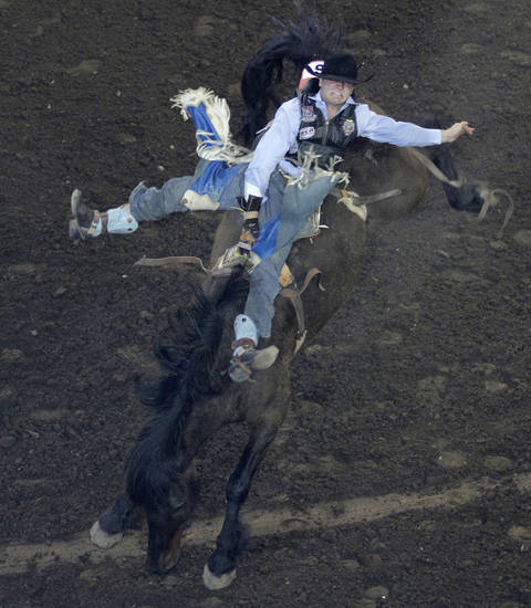 Seth Hardwick, of Laramie, Wyo., competes in bareback riding during the Ram National Circuit Finals Rodeo Championship in Oklahoma City, Sunday, April 1, 2012.  Photo by Garett Fisbeck, For The Oklahoman