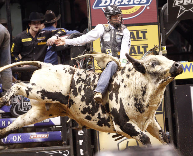 PROFESSIONAL BULL RIDERS: Cord McCoy rides Wild Willie during a PBR event at the Oklahoma City Arena, Saturday, Feb. 12, 2011.  Photo by Bryan Terry, The Oklahoman ORG XMIT: KOD