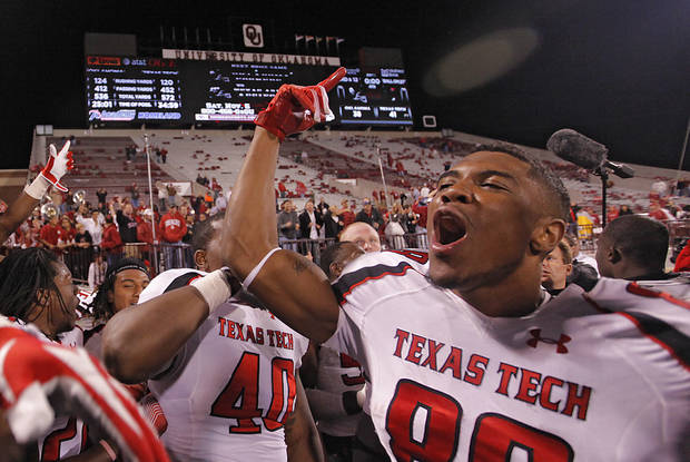 Texas Tech's Marcus Kennard (88) celebrates the 41-38 win over Oklahoma during the college football game between the University of Oklahoma Sooners (OU) and Texas Tech University Red Raiders (TTU) at the Gaylord Family-Oklahoma Memorial Stadium on Sunday, Oct. 23, 2011. in Norman, Okla. Photo by Chris Landsberger, The Oklahoman