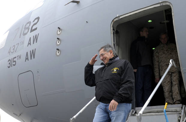 U.S. Defense Secretary Leon Panetta salutes as he walks off of his plane after arriving at Kandahar Airfield in Kandahar, Afghanistan, Thursday, Dec. 13, 2012. (AP Photo/Susan Walsh, Pool)