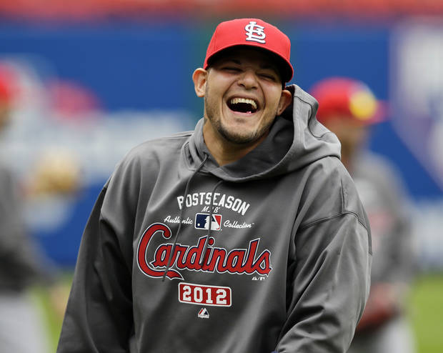 St. Louis Cardinals catcher Yadier Molina laughs during batting practice at Nationals Park, Tuesday, Oct. 9, 2012, in Washington. The Cardinals take on the Washington Nationals on Wednesday in Game 3 of the National League division series. The best-of-five games series is tied 1-1. (AP Photo/Alex Brandon)