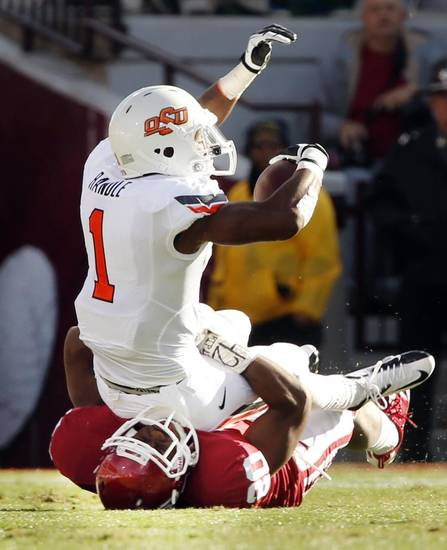 Oklahoma State's Joseph Randle (1) is brought down for short gain by Oklahoma's Frank Shannon (20) during the Bedlam college football game between the University of Oklahoma Sooners (OU) and the Oklahoma State University Cowboys (OSU) at Gaylord Family-Oklahoma Memorial Stadium in Norman, Okla., Saturday, Nov. 24, 2012. Photo by Steve Sisney, The Oklahoman
