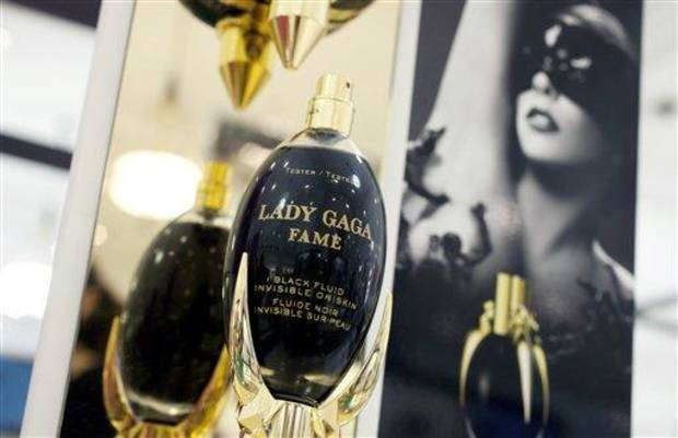In this Aug. 23, 2012, photo, Fame perfume from the Lady Gaga collection is displayed at a Lord & Taylor department store in New York. Celebrities have long dabbled in design, but with the growth of TV shows and websites that follow everything celebrities say, wear and do, interest in their clothing lines has risen in recent years. North America revenue from celebrity clothing lines, excluding merchandise linked to athletes, rose 6 percent last year to an historic peak of $7.58 billion in 2011, according to the latest figures available by The Licensing Letter, an industry trade. That�s on top of a nearly 5 percent increase in 2010. (AP Photo/Mark Lennihan)
