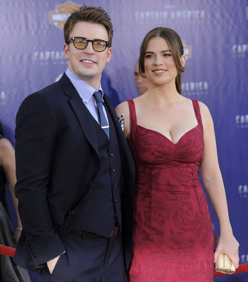 "Chris Evans, left, and Hayley Atwell, cast members in ""Captain America: The First Avenger,"" pose together at the premiere of the film in Los Angeles, Tuesday, July 19, 2011. The film is to be released on Friday, July 22. (AP Photo/Chris Pizzello)"