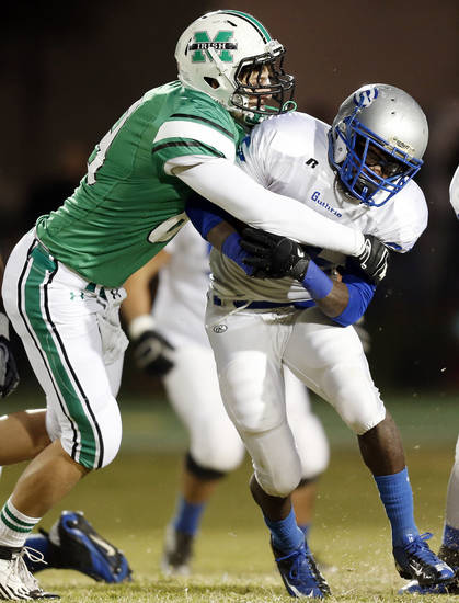 David Love (89) of Bishop McGuinness tackles Guthrie's J.T. McFadden (25) during a high school football game between Bishop McGuinness and Guthrie at Bishop McGuinness Catholic High School in Oklahoma City, Friday, Oct. 26, 2012. Photo by Nate Billings, The Oklahoman