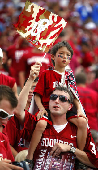 Timothy Richards holds his son Thomas, 7, as before the college football game between the University of Oklahoma Sooners (OU) and the Air Force Falcons at Gaylord Family-Oklahoma Memorial Stadium on Saturday, Sept. 18, 2010, in Norman, Okla.   Photo by Steve Sisney, The Oklahoman