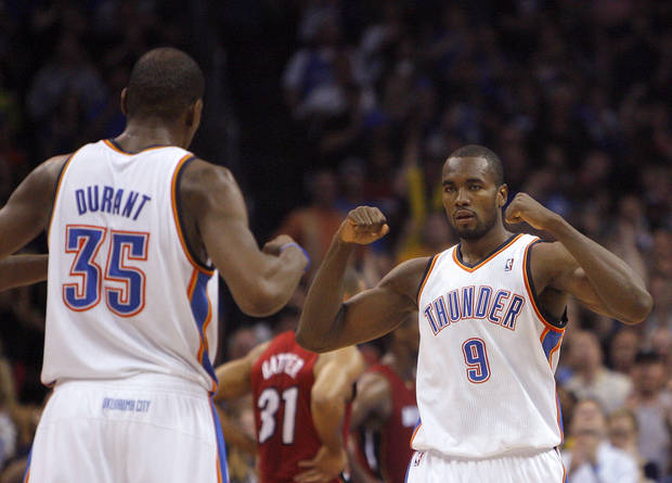 Oklahoma City's Kevin Durant (35) celebrates with Oklahoma City Thunder's Serge Ibaka (9) during the NBA basketball game between the Miami Heat and the Oklahoma City Thunder at Chesapeake Energy Arena in Oklahoma City, Sunday, March 25, 2012. Photo by Sarah Phipps The Oklahoman