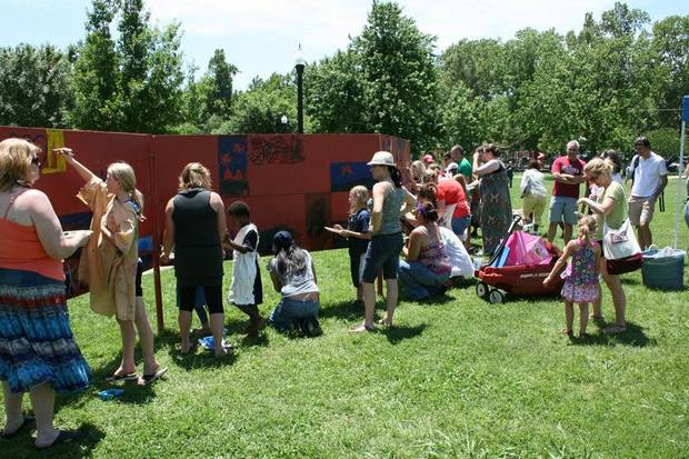 Norman families paint on the Children�s Art Wall in Lions Park at last year�s Luncheon on the Grass event.Photo provided