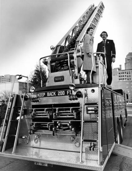 """Latest weapon in Oklahoma City firefighters' arsenal is this $100,451 Ward LaFrance rear-mount aerial ladder unit, purchased with revenue sharing funds.  Delivered Monday, the truck was parked at the Municipal Building this morning in time for viewing by city council members and Mayor Patience Latting, pictured with Fire Capt. Paul Owens."" Staff photo by Roger Klock taken 12/5/78; photo ran in the 12/5/78 Oklahoma City Times."