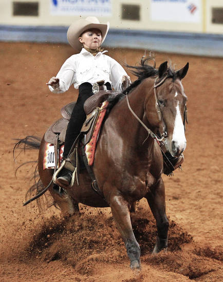Jo Jo Roberson, of Lees Summit, Mo., competes Saturday at the American Quarter Horse Youth  Association�s world championship at State Fair Park.  Photo by Jim Beckel, The Oklahoman