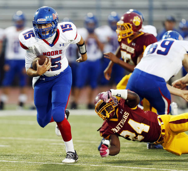 Moore quarterback Colin Webb (15) keeps the ball during a high school football game between Putnam City North and Moore at Putnam City Stadium in Oklahoma City, Thursday, Sept. 27, 2012. Photo by Nate Billings, The Oklahoman