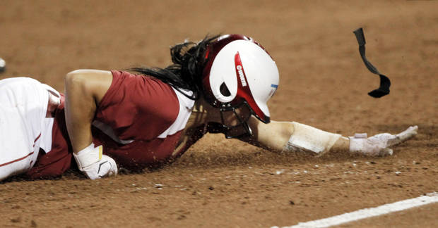 Oklahoma first baseman Lauren Chamberlain slides into third base in the final inning of the WCWS Finals second game where Oklahoma defeated Tennessee 4-0 on June 4, 2013 to win the NCAA championship. Photo by KT KING, The Oklahoman