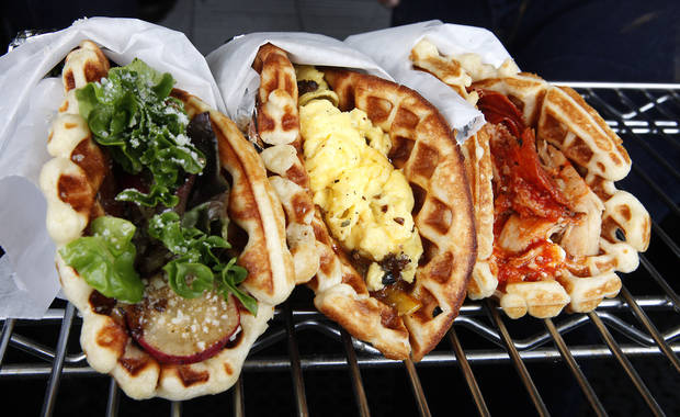 Waffle Champion, a mobile kitchen, serves sweet and savory waffles made to order. Photo By David McDaniel/The Oklahoman
