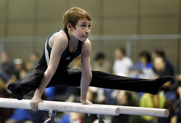 Palmer Wright, 9, with Dynamo gymnastics in Oklahoma City competes in the bars at the Bart Connor Invitational Sports Festival on Saturday, Feb. 16, 2013  in Oklahoma City, Okla. Photo by Steve Sisney, The Oklahoman