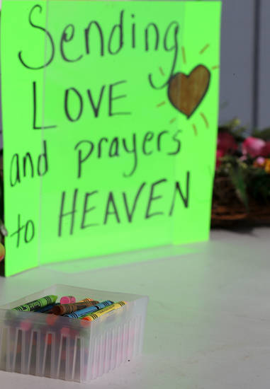 Crayons sit on a table outside of a barbershop a day after a gunman opened fire at Sandy Hook Elementary School, Saturday, Dec. 15, 2012, in the Sandy Hook village of Newtown, Conn. The massacre of 26 children and adults at Sandy Hook Elementary school elicited horror and soul-searching around the world even as it raised more basic questions about why the gunman, 20-year-old Adam Lanza, would have been driven to such a crime and how he chose his victims.  (AP Photo/Julio Cortez)