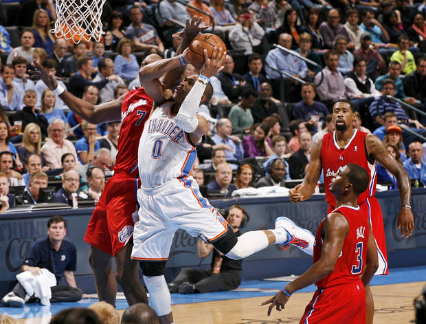 Oklahoma City's Russell Westbrook (0) goes to the basket between the Clippers Lamar Odom (7), Chris Paul (3), and DeAndre Jordan (6) during an NBA basketball game between the Oklahoma City Thunder and the Los Angeles Clippers at Chesapeake Energy Arena in Oklahoma City, Wednesday, Nov. 21, 2012. Photo by Bryan Terry, The Oklahoman