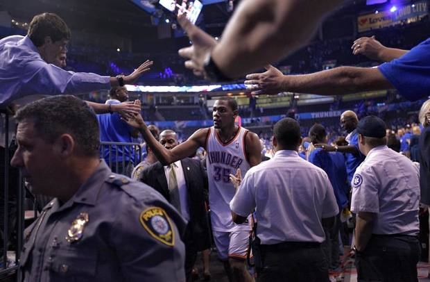 Oklahoma City's Kevin Durant (35) is greeted by fans as he walks off the court after the 107-103 win over Denver during the first round NBA basketball playoff game between the Oklahoma City Thunder and the Denver Nuggets on Sunday, April 17, 2011, in Oklahoma City, Okla. Photo by Chris Landsberger, The Oklahoman ORG XMIT: KOD