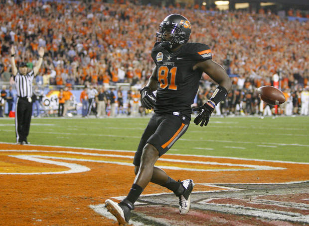 Oklahoma State's Justin Blackmon (81) scores a touchdown during the Fiesta Bowl between the Oklahoma State University Cowboys (OSU) and the Stanford Cardinal at the University of Phoenix Stadium in Glendale, Ariz., Monday, Jan. 2, 2012. Photo by Bryan Terry, The Oklahoman