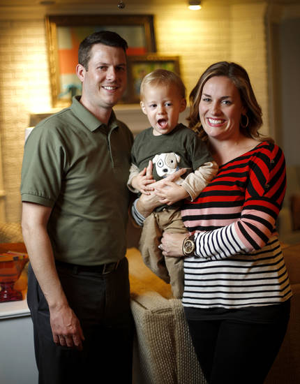 CHILL FAMILY / JEFF CHILL / GRIFFIN CHILL: Jeff and Karlee Chill pose for a photo with their son Griffin, 2, at their Oklahoma City home, Tuesday, October 30, 2012. Griffin has Alpers Syndrome and his brother Logan passed away in August from the disease.  Photo by Bryan Terry, The Oklahoman