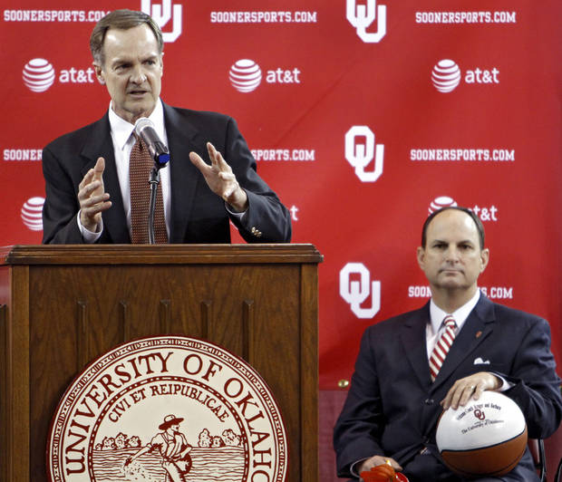University of Oklahoma athletic director Joe Castiglione looks on as new men's basketball coach Lon Kruger speaks while being introduced as the new University of Oklahoma men's basketball coach on Monday, April 4, 2011, in Norman, Okla.