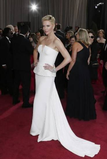 Charlize Theron strikes a pose on the Oscars red carpet. (AP)