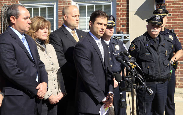 "New Hampshire Assistant Attorney General James Vara, center, gives a news conference in Dover, N.H. on Saturday, Oct. 13, 2012 in Dover, N.H. announcing that University of New Hampshire student, Elizabeth ""Lizzi"" Marriott who disappeared earlier in the week, is dead, and a man has been charged with second-degree murder. (AP Photo/Jim Cole)"