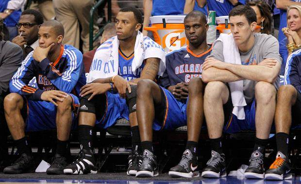 Oklahoma City's Eric Maynor, left, Daequan Cook, Nazr Mohammed, and Nick Collison sit on the bench during game 1 of the Western Conference Finals in the NBA basketball playoffs between the Dallas Mavericks and the Oklahoma City Thunder at American Airlines Center in Dallas, Tuesday, May 17, 2011. Photo by Bryan Terry, The Oklahoman