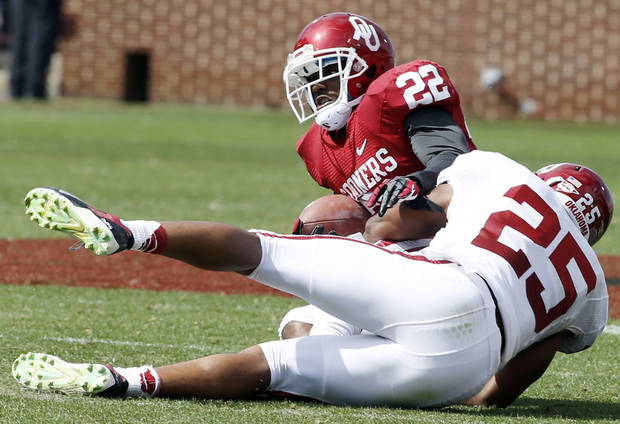 Roy Finch (22) is brought down by Aaron Franklin (25) after a pass reception during the annual Spring Football Game at Gaylord Family-Oklahoma Memorial Stadium in Norman, Okla., on Saturday, April 13, 2013. Photo by Steve Sisney, The Oklahoman