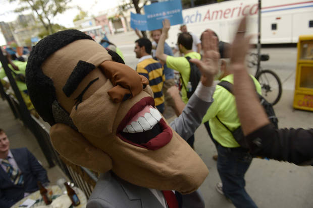 Obama supporters gather outside the Ritchie Center at the first 2012 Presidential Debate at the University of Denver, Wednesday, Oct. 3, 2012 in Denver. (AP Photo/The Denver Post, Helen H. Richardson) MAGS OUT; TV OUT; INTERNET OUT; NO SALES ORG XMIT: CODEN308