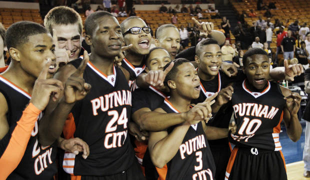 The Putnam City Pirates pose for a photo following the Class 6A high school basketball state tournament final between Putnam City and Midwest City at the ORU Mabee Center in Tulsa, Okla., Saturday, March 13, 2010. Putnam City won, 68-59. Photo by Nate Billings, The Oklahoman
