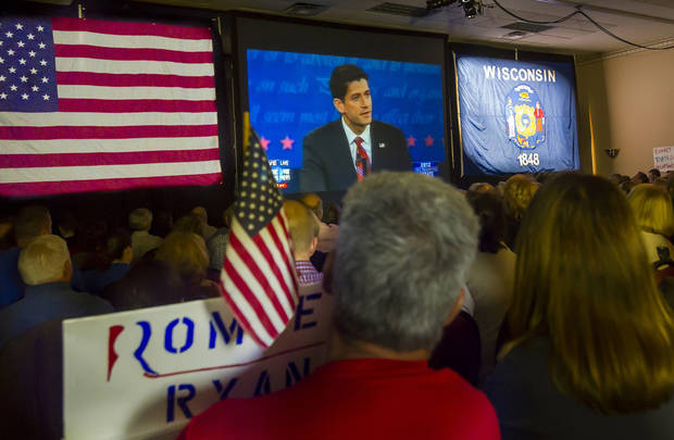 Supporters of Republican vice presidential nominee Rep. Paul Ryan, of Wisconsin, gather at the Holiday Inn Express in Janesville, Wis. to watch his debate with Vice President Joe Biden on Thursday, Oct. 11, 2012. (AP Photo/The Janesville Gazette, Mark Kauzlarich)