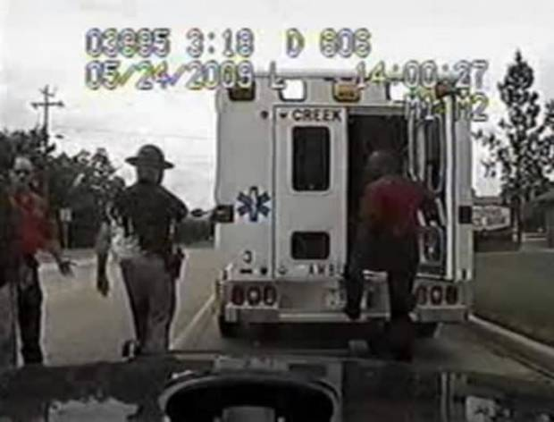 In this image taken from video provided by the Oklahoma Highway Patrol, Trooper  Daniel  Martin, center left, gets in an altercation with paramedics after the ambulance failed to get out of his way quickly enough as he approached with his sirens on, in Oklahoma City on May 24, 2009. (AP Photo/Oklahoma Highway Patrol)