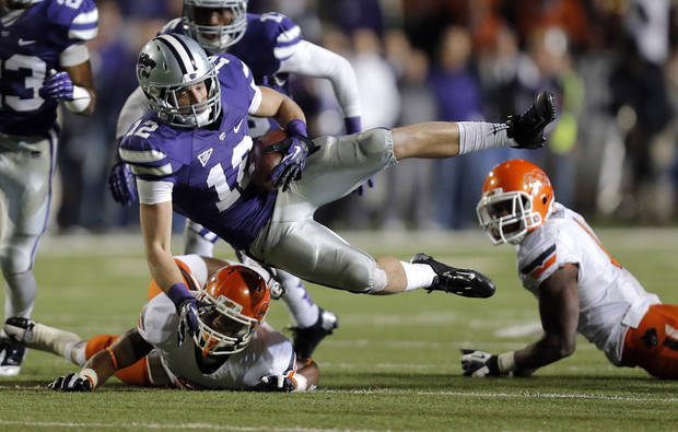 Kansas State's Ty Zimmerman (12) is tripped up by Oklahoma State's Josh Stewart (5) after a fumble recovery during the college football game between the Oklahoma State University Cowboys (OSU) and the Kansas State University Wildcats (KSU) at Bill Snyder Family Football Stadium on Saturday, Nov. 1, 2012, in Manhattan, Kan. Photo by Chris Landsberger, The Oklahoman