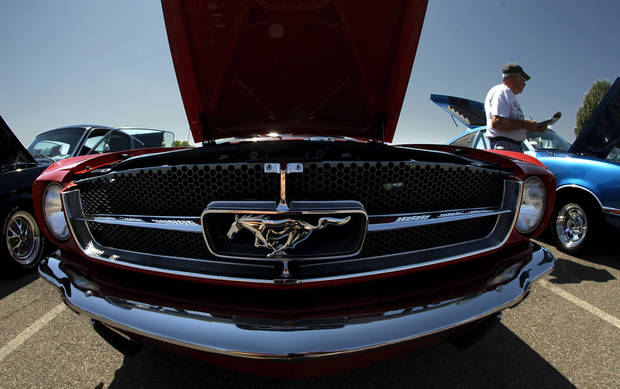 Right: Muscle cars line the streets of Mustang at the Ford Mustang Grand National car show.